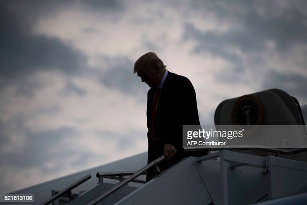 US President Donald Trump disembarks from Air Force One upon arrival at Raleigh County Memorial Airport in Beaver West Virginia July 24 as Trump...