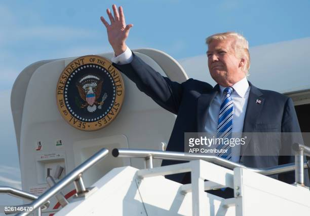 US President Donald Trump disembarks from Air Force One upon arrival at TriState Airport in Huntington West Virginia August 3 as he travels to a Make...