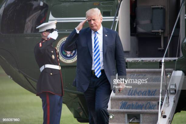 President Donald Trump disembarks Marine One after returning from the NRA Leadership Forum in Dallas