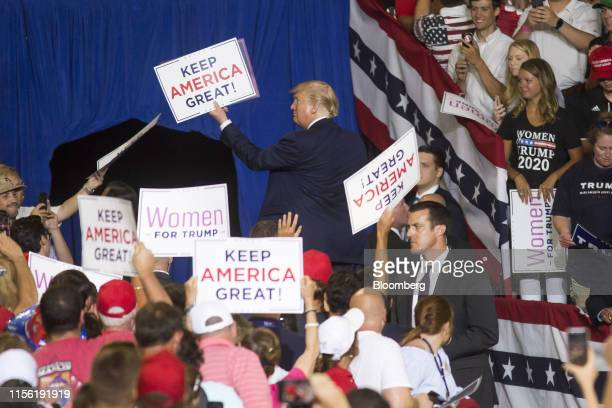 US President Donald Trump displays a sign that reads Keep America Great as he leaves the stage during a rally in Greenville North Carolina US on...