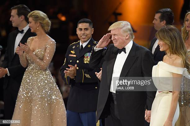 President Donald Trump does the Army salute with Lady Melania Trump his daughter Ivanka and son-in-law Jared Kushner during the Salute to Our Armed...