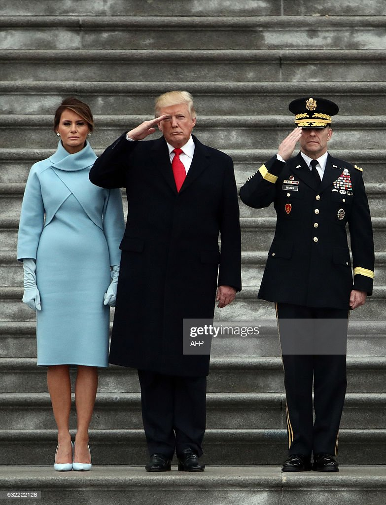 President Donald Trump (Donald Trump (C), with first lady Melania Trump (L) and Maj. Gen. Bradley Becker review troops on the East Front of the US Capitol on January 20, 2017 in Washington, DC. Donald Trump was sworn in as the 45th president of the United States Friday -- ushering in a new political era that has been cheered and feared in equal measure. / AFP / POOL / Michael Heiman