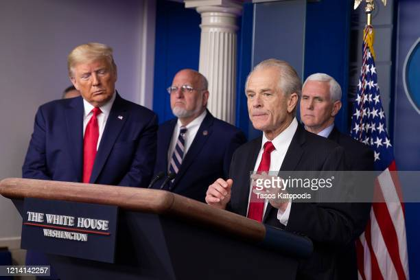 President Donald Trump Dr Robert Redfield Director of the Center for Disease Control and Prevention and Vice President Mike Pence listen to Peter...