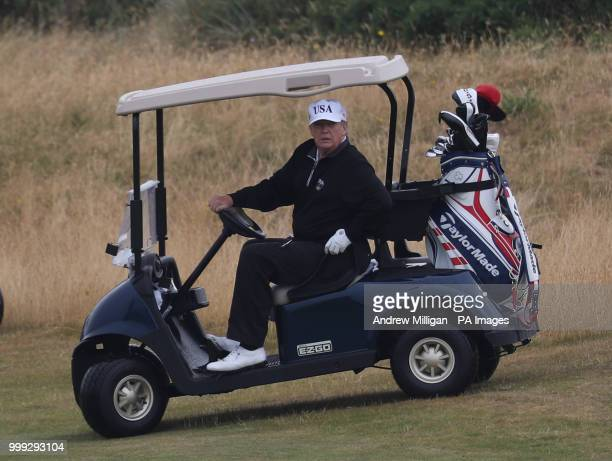 US President Donald Trump drives a golf buggy on his golf course at the Trump Turnberry resort in South Ayrshire where he and his wife Melania spent...