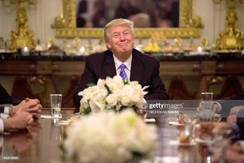 President Donald Trump during a reception with Congressional leaders on January 23, 2017 at the White House in Washington, DC. / AFP / NICHOLAS