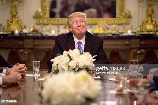 President Donald Trump during a reception with Congressional leaders on January 23 2017 at the White House in Washington DC / AFP / NICHOLAS KAMM