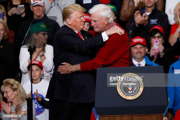 S President Donald Trump embraces former Indiana University basketball coach Bobby Knight during a campaign rally on November 2 2018 at Southport...