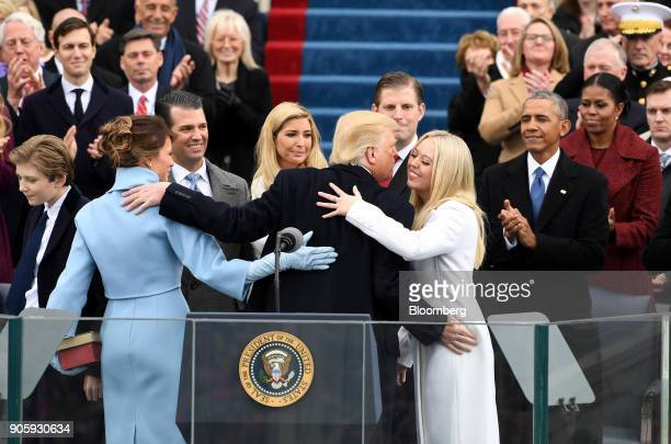 President Donald Trump embraces his family during the 58th presidential inauguration in Washington, D.C., U.S., on Friday, Jan. 20, 2017. The one...