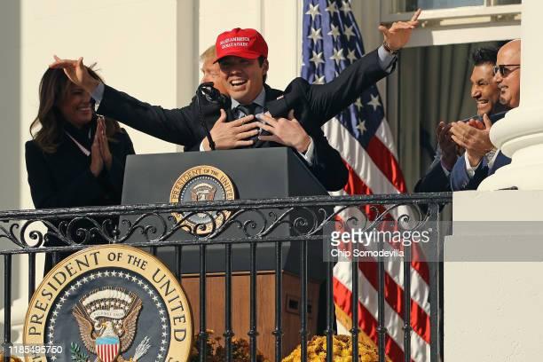 S President Donald Trump embraces Washington National catcher Kurt Suzuki as he wears a 'Make America Great Again' cap during a celebration of the...