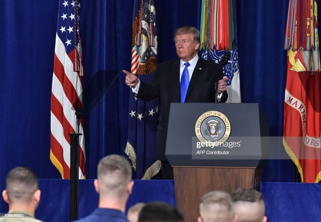 US President Donald Trump ends his address to the nation from Joint Base Myer-Henderson Hall in Arlington, Virginia, on August 21, 2017. Trump warned Pakistan on Monday that Washington will no longer tolerate Pakistan offering 'safe havens' to extremists. 'Pakistan has much to gain from partnering with our effort in Afghanistan,' he said. 'It has much to lose by continuing to harbor criminals and terrorists.' / AFP PHOTO / Nicholas Kamm