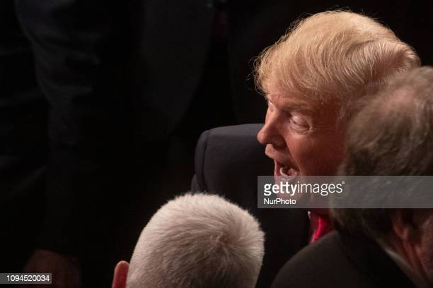 US President Donald Trump enters the chamber of the US House of Representatives to deliver his second State of the Union address to a joint session...