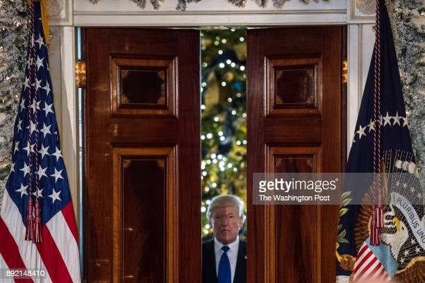 President Donald Trump enters the Grand Foyer of the White House before making remarks on tax reform on Wednesday Dec 13 in Washington