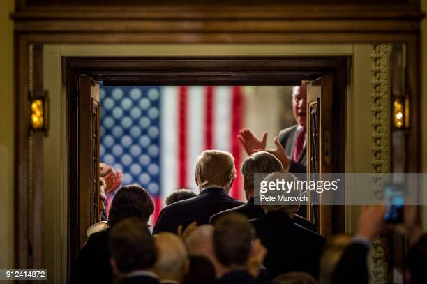 S President Donald Trump enters the House of Representatives chamber to deliver his first State of the Union Address before a joint session of...