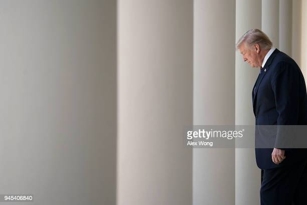S President Donald Trump enters the Rose Garden for an event April 12 2018 at the White House in Washington DC President Trump gave remarks on tax...