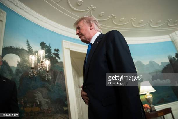 S President Donald Trump exits after making a statement on the administration's strategy for dealing with Iran in the Diplomatic Reception Room in...