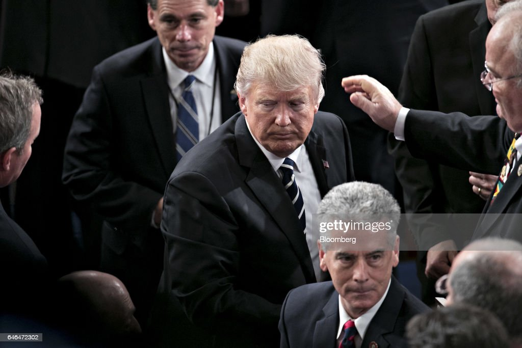 U.S. President Donald Trump exits after speaking during a joint session of Congress in Washington, D.C., U.S., on Tuesday, Feb. 28, 2017. Trump will press Congress to carry out his priorities for replacing Obamacare, jump-starting the economy and bolstering the nations defenses in an address eagerly awaited by lawmakers, investors and the public who want greater clarity on his policy agenda. Photographer: Andrew Harrer/Bloomberg via Getty Images