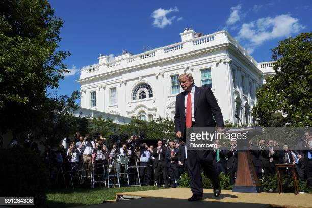 US President Donald Trump exits following an announcement in the Rose Garden of the White House in Washington DC US on Thursday June 1 2017 Trump...