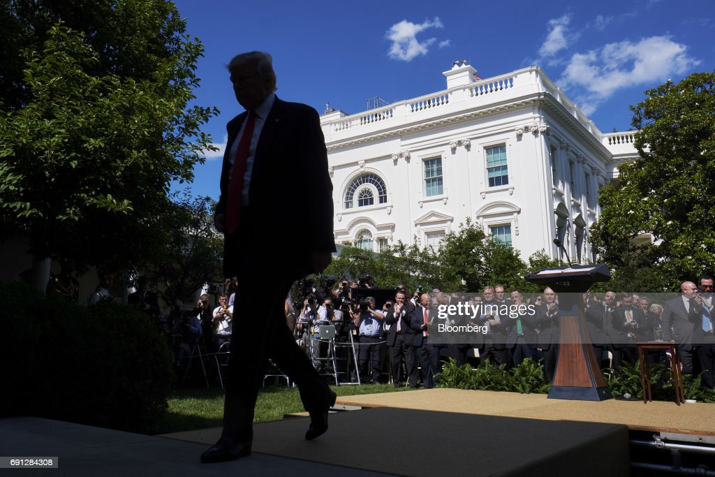 U.S. President Donald Trump exits following an announcement in the Rose Garden of the White House in Washington, D.C., U.S., on Thursday, June 1, 2017. Trump announced the U.S. would withdraw from the Paris climate pact and that he will seek to renegotiate the international agreement in a way that treats American workers better. Photographer: T.J. Kirkpatrick/Bloomberg via Getty Images