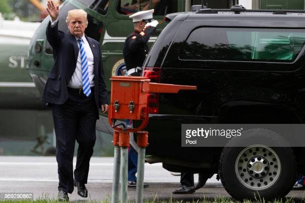 US President Donald Trump exits Marine One and enters a waiting SUV as he visits first lady Melania Trump at Walter Reed Medical Center on May 16...