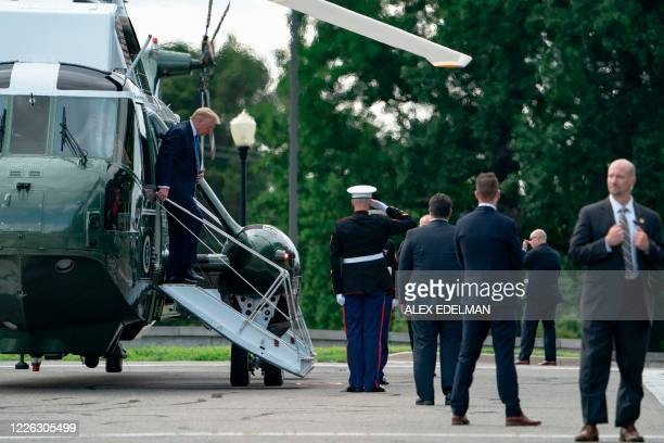 US President Donald Trump exits Marine One as he arrives to visit Walter Reed National Military Medical Center in Bethesda Maryland on July 11 2020