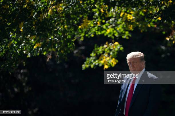 President Donald Trump exits the Oval Office and walks toward Marine One on the South Lawn of the White House on September 30, 2020 in Washington,...