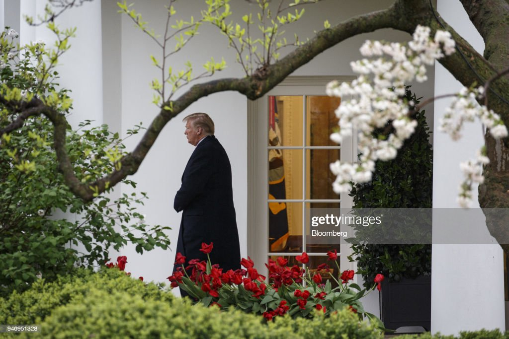 U.S. President Donald Trump exits the White House while departing for Miami from the South Lawn in Washington, D.C., U.S. on Monday, April 16, 2018. Trump accused China and Russia of devaluing their currencies, opening a new front in his argument that foreign governments are taking advantage of the U.S. economy to support their own expansions. Photographer: Joshua Roberts/Bloomberg via Getty Images