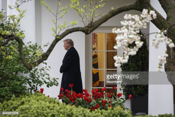 US President Donald Trump exits the White House while departing for Miami from the South Lawn in Washington DC US on Monday April 16 2018...