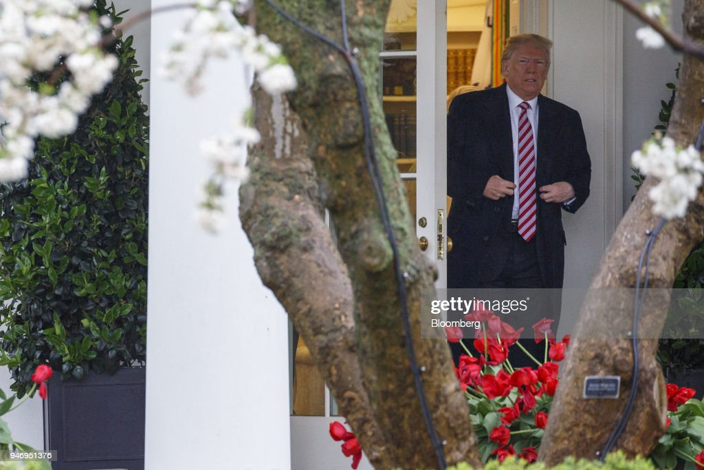 U.S. President Donald Trump exits the White House while departing for Miami from the South Lawn in Washington, D.C., U.S. on Monday, April 16, 2018. Trumpaccused China and Russia of devaluing their currencies, opening a new front in his argument that foreign governments are taking advantage of the U.S. economy to support their own expansions. Photographer: Joshua Roberts/Bloomberg via Getty Images