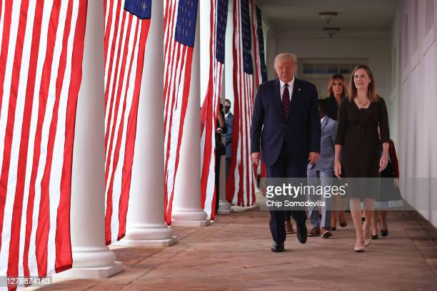 President Donald Trump first lady Melania Trump 7th US Circuit Court Judge Amy Coney Barrett and her family walk along the Rose Garden Colonnade...