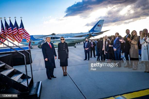 President Donald Trump, First Lady Melania Trump abd family members acknowledg supporters at Joint Base Andrews before boarding Air Force One for his...