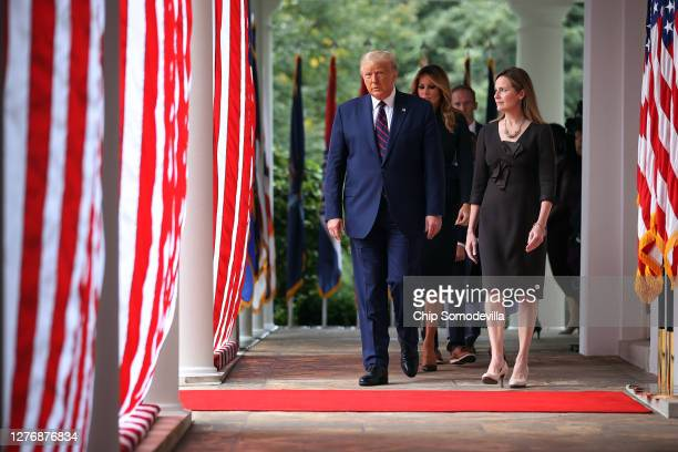 President Donald Trump first lady Melania Trump and 7th US Circuit Court Judge Amy Coney Barrett walk into the Rose Garden before Trump announces...