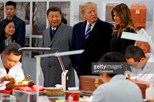 US President Donald Trump First Lady Melania Trump and China's President Xi Jinping tour the Conservation Scientific Laboratory of the Forbidden City...