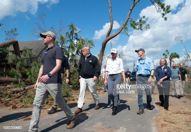 US President Donald Trump First Lady Melania Trump and Florida Governor Rick Scott and DHS Secretary Kirstjen Nielsen tour damage from Hurricane...