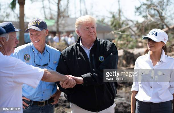 US President Donald Trump First Lady Melania Trump and Florida Governor Rick Scott tour damage from Hurricane Michael in Lynn Haven Florida October...