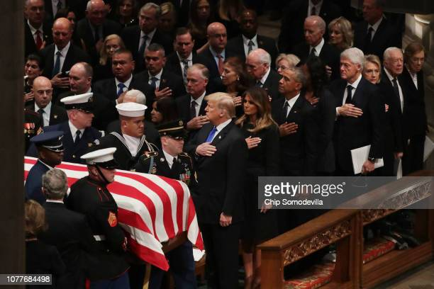 President Donald Trump, first lady Melania Trump and former presidents, vice presidents, first ladies and spouses attend the state funeral for former...