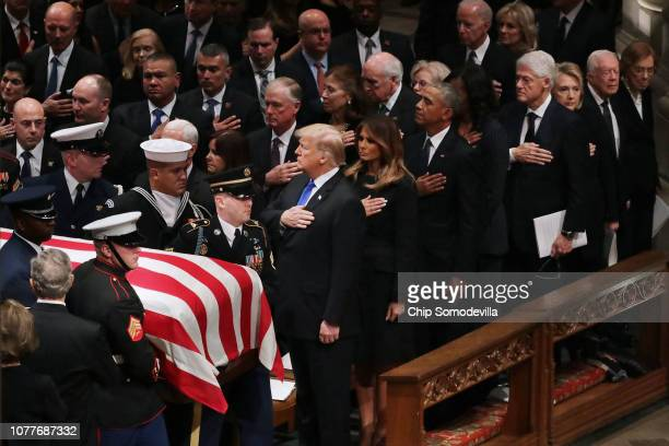 President Donald Trump first lady Melania Trump and former presidents vice presidents first ladies and spouses attend the state funeral for former...