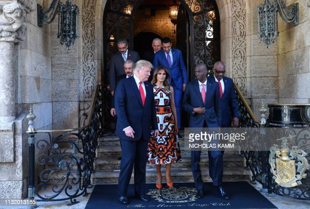 US President Donald Trump first lady Melania Trump and Haitain President Jovenel Moïse arrive for a photo opportuniny with Caribbean leaders at the...