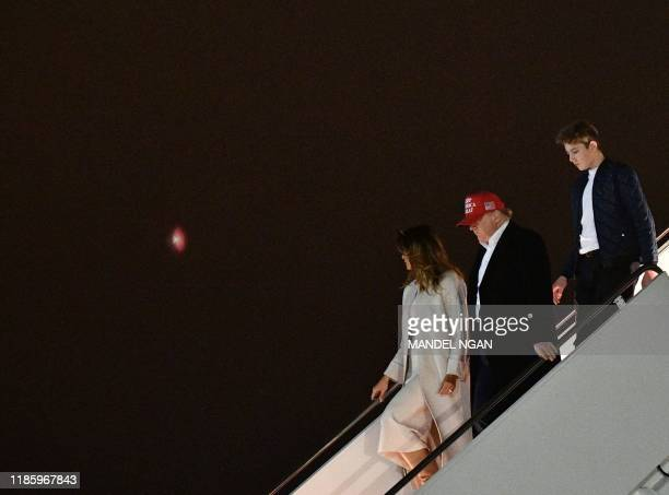 US President Donald Trump First Lady Melania Trump and son Barron step off Air Force One upon arrival at Andrews Air Force Base Maryland on December...