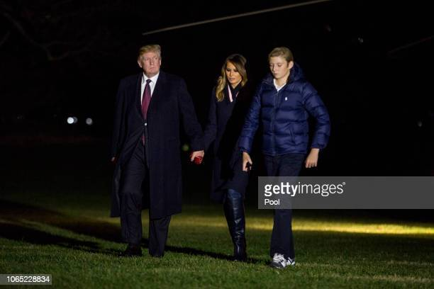 S President Donald Trump first lady Melania Trump and son Barron Trump cross the South Lawn of the White House November 25 2018 in Washington DC The...