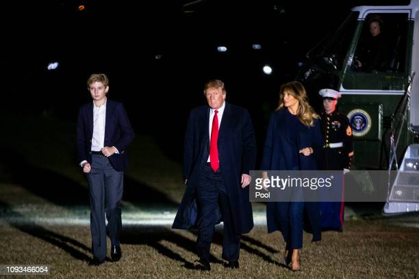 S President Donald Trump first lady Melania Trump and son Barron Trump arrive aboard Marine One on the South Lawn of the White House February 3 2019...