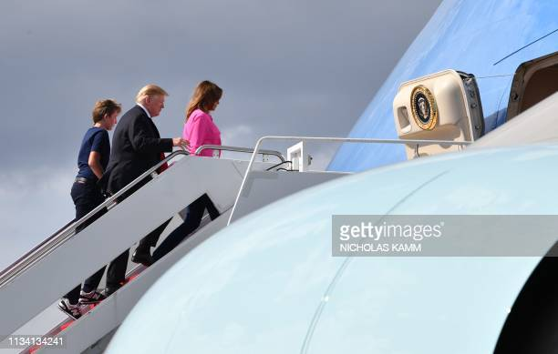 US President Donald Trump first lady Melania Trump and son Barron Trump board Air Force One upon departure from West Palm Beach International Airport...