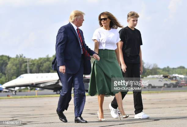 US President Donald Trump First Lady Melania Trump and son Barron Trump board Air Force One in Morristown New Jersey on August 18 2019