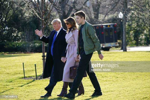 US President Donald Trump First Lady Melania Trump and son Barron Trump make their way to board Marine One from the South Lawn of the White House in...