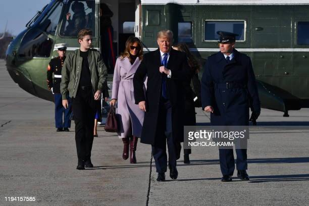 US President Donald Trump First Lady Melania Trump and son Barron Trump make their way to board Air Force One at Andrews Airforce Base Maryland on...