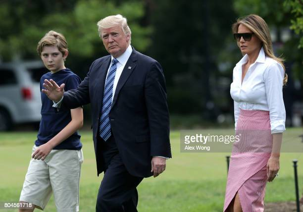 President Donald Trump, first lady Melania Trump and son Barron Trump walk on the South Lawn prior to a Marine One departure at the White House June...