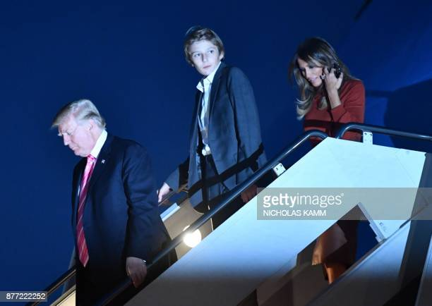 US President Donald Trump First Lady Melania Trump and son Barron Trump step off Air Force One at the Palm Beach International airport in Palm Beach...