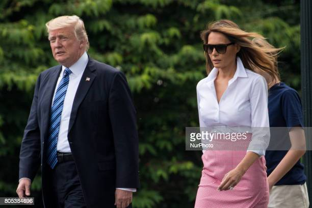 President Donald Trump First Lady Melania Trump and their 11yearold son Barron walk across the South Lawn of the White House to board Marine One on...
