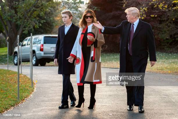 US President Donald Trump First Lady Melania Trump and their son Barron depart the White House in Washington DC on November 20 2018 The Trumps are...