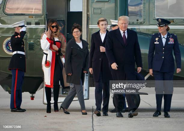 US President Donald Trump First Lady Melania Trump and their son Barron make their way to board Air Force One before departing from Andrews Air Force...