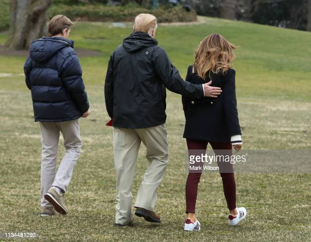 S President Donald Trump First lady Melania Trump and their son Barron walk toward Marine One to depart from the South Lawn of the White House on...